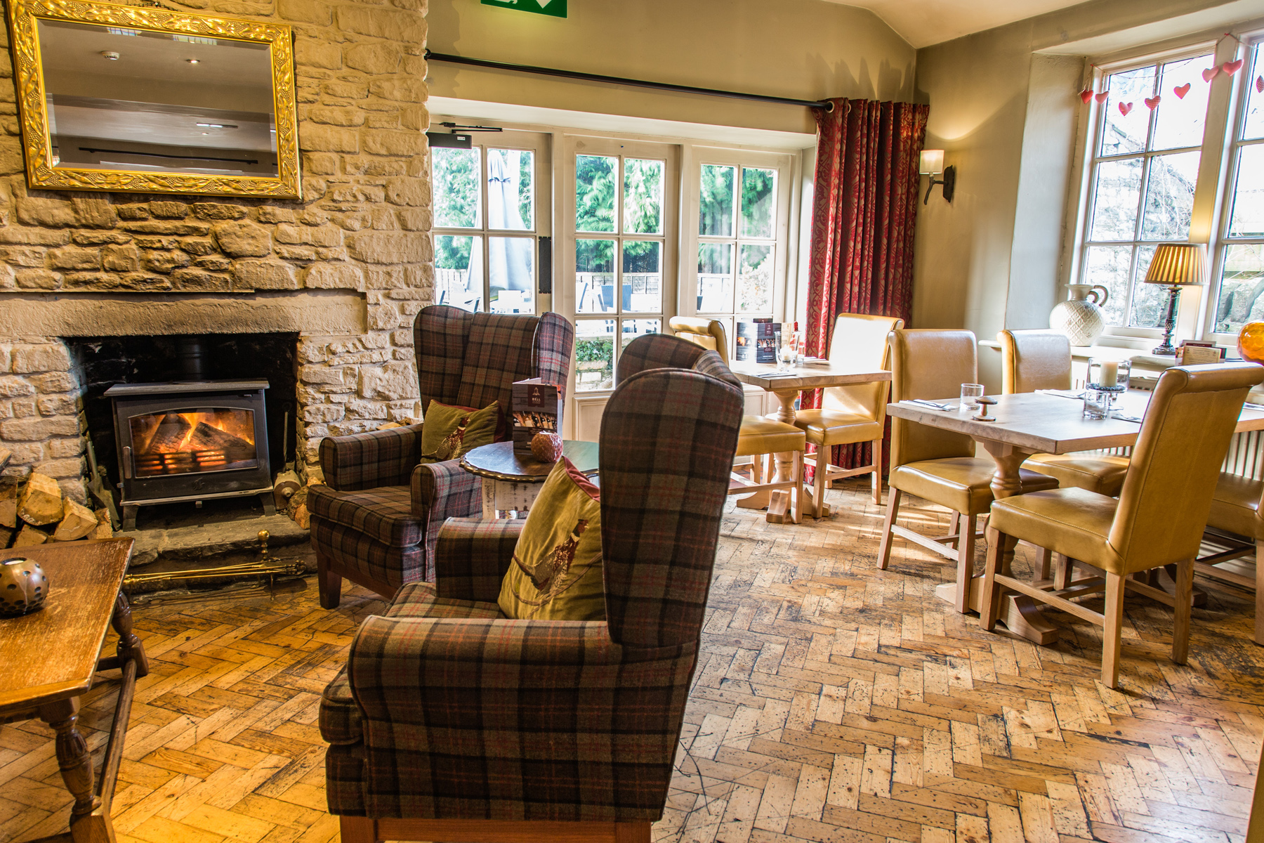 Comfy chairs and a log fire